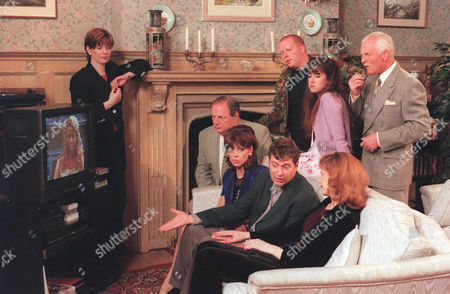 'Emmerdale' TV - 1999 - Stella's (STEPHANIE SCHONFIELD) puzzled guests arrive at Home Farm - but what does the evening hold in store for them? (Seated - background to foreground) Turner (RICHARD THORP), Viv (DEENA PAYNE), Rev Ashley (JOHN MIDDLETON) and Bernice [Samantha Giles].  Back row - background to foreground - Butch (PAUL LOUGHRAN), Tricia [Sheree Murphy], Pollard (CHRIS CHITTELL). Laura  (LOUISE BEATTIE) (standing by fireplace).