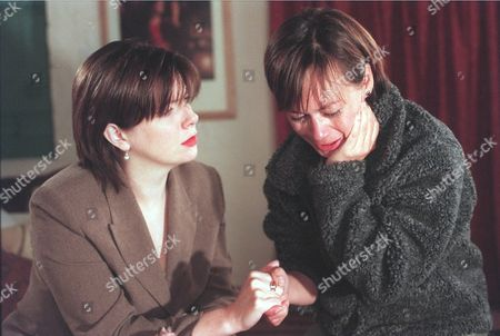'Emmerdale'  TV - 1999 - Zoe (LEAH BRACKNELL) is distraught over Chris's disappearance, Laura (LOUISE BEATTIE) comforts her.
