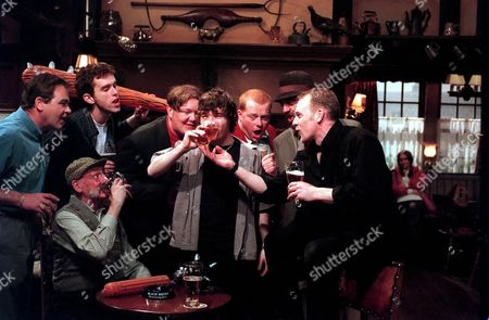 'Emmerdale'  TV - 1999 - The lads enjoy Roy's stag night! Pictured: (L-R standing) Terry (BILLY HARTMAN), Marlon (MARK CHANOCK), Paddy (DOMINIC BRUNT), Roy (NICKY EVANS), Butch (PAUL LOUGHRAN), Biff (STUART WADE) and (seated) Seth (STAN RICHARDS).