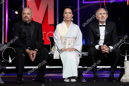 Francis Ford Coppola, Jean-Pierre Jeunet, Anton Corbijn Jury members, from left to right, French director and screenwriter Jean-Pierre Jeunet, Japanese director Naomi Kawase and director and photographer Anton Corbijn from The Netherlands attend the opening night of the 15th Marrakech International Film Festival in Marrakech, Morocco, . The festival runs from Dec. 4-12