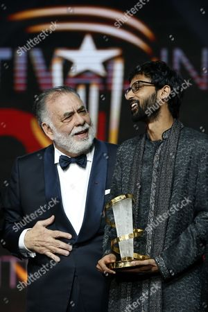 "Raam Reddy, Francis Ford Coppola U.S. Director Francis Ford Coppola, right, chats with Indian director Raam Reddy after winning the jury prize for his film "" Thithi"" during the closing ceremony of the the 15th Marrakech International Film in Marrakech, . JURY PRIZE given to each film of the competition except the Grand Prize except - THE GOLDEN STAR"