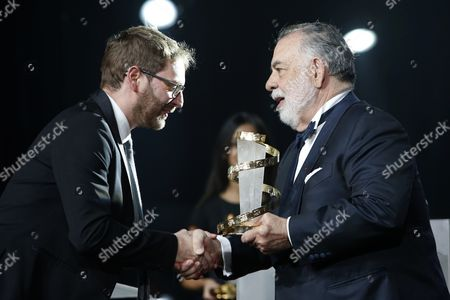 "Guillaume Senez, Francis Ford Coppola U.S. Director Francis Ford Coppola, right, gives an award to Belgian director Guillaume Senez after winning the jury prize for his film "" Keeper "" during the closing ceremony of the the 15th Marrakech International Film in Marrakech, . JURY PRIZE given to each film of the competition except the Grand Prize except - THE GOLDEN STAR"