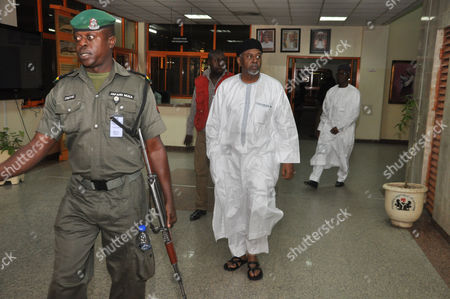 Nigeria's former national security adviser Sambo Dasuki, centre, arrives for a hearing to face charges of possessing weapons illegally, at the Federal High Court in Abuja, Nigeria, . Nigeria's former national security adviser says $47 million was withdrawn in cash from the Central Bank on the order of former President Goodluck Jonathan and was used to pay delegates at a party presidential nomination conference. Retired Col. Sambo Dasuki submitted the written statement before he was charged Monday at the Federal High Court with 19 counts of money-laundering and criminal breach of trust connected to the disappearance of $2.1 billion meant to buy arms to fight Boko Haram