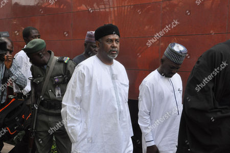 Nigeria's former national security adviser Sambo Dasuki, centre, arrives for a hearing on charges of possessing weapons illegally, at the Federal High Court in Abuja, Nigeria., Nigeria's former national security adviser says $47 million was withdrawn in cash from the Central Bank on the order of former President Goodluck Jonathan and was used to pay delegates at a party presidential nomination conference