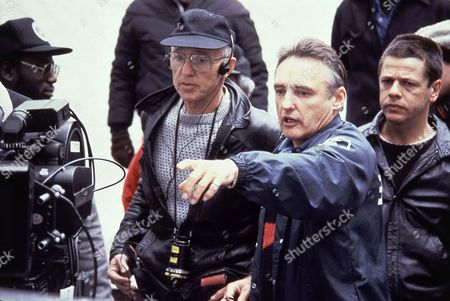 """Haskell Wexler, Dennis Hopper Director Dennis Hopper, second from right, with cinematographer Haskel Wexler, third from right, during the making of the movie """"Colors."""" Wexler, the two-time Oscar-winning cinematographer and prominent social activist, died . He was 93"""