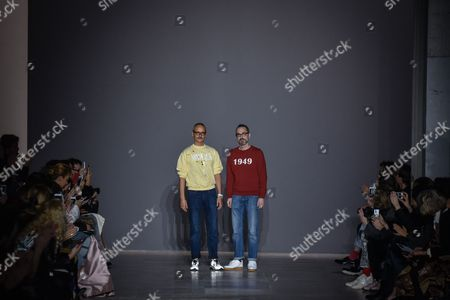 Dutch fashion designers Viktor Horsting, left, and Rolf Snoeren acknowledge applause from the audience after Viktor and Rolf's Spring-Summer 2016 Haute Couture fashion collection, presented in Paris, France