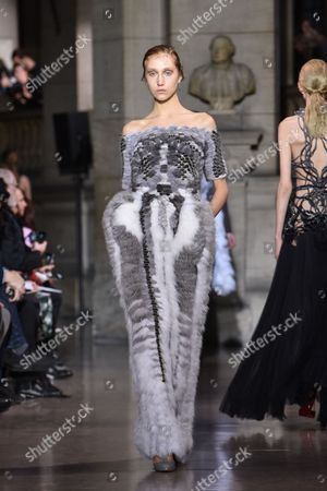 Stock Picture of A model wears a creation as part of Yiqing Yin's Spring-Summer 2016 Haute Couture fashion collection, presented in Paris, France