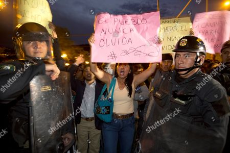 """Protesters shout slogans against presidential candidate Keiko Fujimori, with a poster that reads in Spanish: """"The people will never forget,"""" near Fujimori's campaign rally in Ayacucho, Peru. Some Peruvians fear a President Keiko would pardon her father, Alberto Fujimori, and that his discredited syndicate would then insinuate itself back into power"""