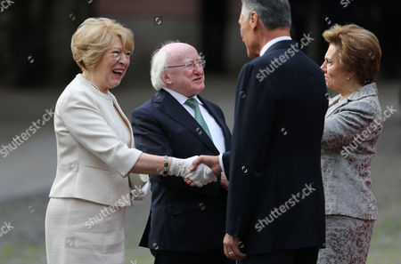 Ireland's President Michael Higgins, center left, and his wife Sabina greet Portuguese President Anibal Cavaco Silva and his wife Maria upon arriving at the Belem presidential palace in Lisbon . Higgins arrived in Portugal Wednesday for a three-day state visit