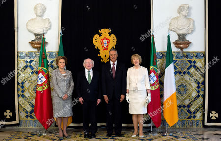 Stock Photo of Ireland's President Michael Higgins, center left, and his wife Sabina, right, pose for photos with Portuguese President Anibal Cavaco Silva and his wife Maria upon arriving at the Belem presidential palace in Lisbon . Higgins arrived in Portugal Wednesday for a three-day state visit