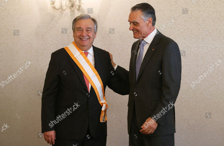 Antonio Guterres, former UN High Commissioner for Refugees, smiles after being decorated by Portuguese President Anibal Cavaco Silva, right, with the Great Cross of the Order of Liberty . The Portuguese government has proposed Guterres as a candidate to replace Ban Ki-moon as next UN Secretary General