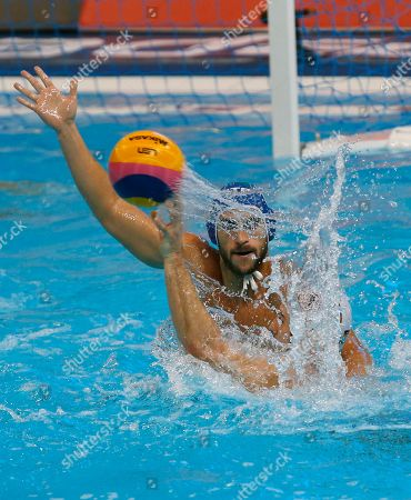 Italy's Valentino Gallo, top, challenges for the ball with Germany's Marin Restovic during their qualifying match at the men's European Waterpolo Championships in Belgrade, Serbia