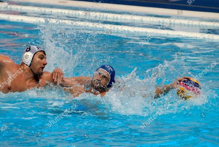 Romania's Mihnea Chioveanu, left, challenges for the ball with Italy's Valentino Gallo during their qualifying match at the men's European Waterpolo Championships in Belgrade, Serbia