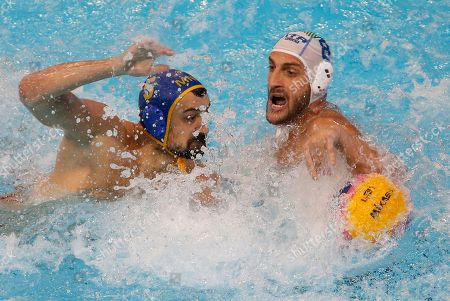 Italy's Valentino Gallo, right, challenges for the ball with Montenegro's Darko Brguljan during the quarter final match at the men's European Waterpolo Championships in Belgrade, Serbia