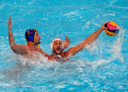 Montenegro's Mladan Janovic, left, challenges for the ball with Italy's Valentino Gallo during their quarter final match at the men's European Waterpolo Championships in Belgrade, Serbia