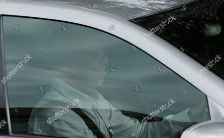 Stock Picture of Arnold Pistorius, drives out of his house where his nephew Oscar Pistorius is staying in Pretoria, South Africa, . A South African appeals court on Thursday convicted Oscar Pistorius of murder, overturning a lower court's conviction of the double-amputee Olympian on the lesser charge of manslaughter for shooting girlfriend Reeva Steenkamp to death in 2013