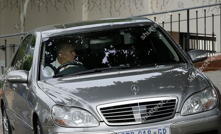 Arnold Pistorius, drives out of his house where his nephew Oscar Pistorius is staying in Pretoria, South Africa, . A South African appeals court on Thursday convicted Oscar Pistorius of murder, overturning a lower court's conviction of the double-amputee Olympian on the lesser charge of manslaughter for shooting girlfriend Reeva Steenkamp to death in 2013
