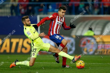 Levante's Jose Mari, left, duels for the ball with Atletico's Angel Correa during a Spanish La Liga soccer match between Atletico de Madrid and Levante at the Vicente Calderon stadium in Madrid, Spain