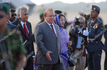 Stock Picture of Kalsoom Nawaz Sharif, Nawaz Sharif, Ranil Wickremasinghe Pakistani Prime Minister Nawaz Sharif, center and his wife Kalsoom Nawaz Sharif walk escorted by Sri Lankan Prime Minister Ranil Wickremasinghe, left, after their arrival at Katunayaka International air port in Colombo, Sri Lanka, . Sharif arrived in Sri Lanka on a three day official visit during which several agreements including money laundering and terrorism are to be signed aiming to strengthening the bilateral relations between the two Asian nations