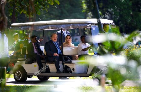 Stock Photo of Nawaz Sharif, Kalsoom Nawaz Sharif Pakistani Prime Minister Nawaz Sharif, seated center, and his wife Kalsoom Nawaz Sharif, take a ride in a cart during their visit to the Peradeniya botanical garden in Kandy, Sri Lanka