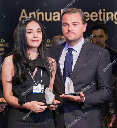 Chinese actress Yao Chen, left, and US Actor Leonardo DiCaprio pose with their trophies for media after Crystal Awards ceremony at the World Economic Forum in Davos, Switzerland, . The world's political and business elite are being urged to do more than pay lip service to growing inequalities around the world as they head off for this week's World Economic Forum in the Swiss ski resort of Davos this week