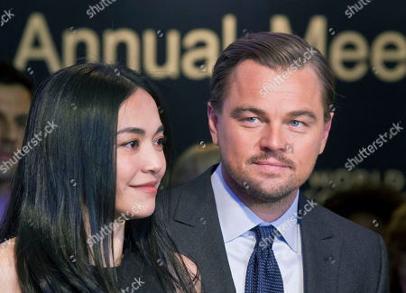Chinese actress Yao Chen, left, and US Actor Leonardo DiCaprio pose for media after the Crystal Awards ceremony at the World Economic Forum in Davos, Switzerland, . The world's political and business elite are being urged to do more than pay lip service to growing inequalities around the world as they head off for this week's World Economic Forum in the Swiss ski resort of Davos this week