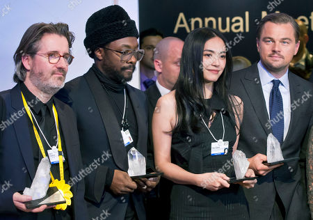 From left, Danish artist Olafur Eliasson, US singer, songwriter and rapper William Adams, Chinese actress Yao Chen and US Actor Leonardo DiCaprio pose for the media with their trophies after the Crystal Awards ceremony at the World Economic Forum in Davos, Switzerland, . The world's political and business elite are being urged to do more than pay lip service to growing inequalities around the world as they head off for this week's World Economic Forum in the Swiss ski resort of Davos this week