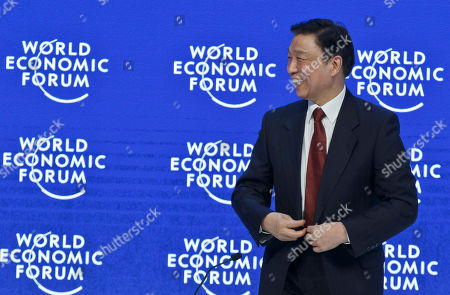 Chinese Vice President Li Yuanchao smiles as he arrives for a special session at the World Economic Forum in Davos, Switzerland, . World leaders are holding a flurry of diplomatic meetings at the World Economic Forum and worried CEOs are debating about how to deal with this year's volatile markets and low oil prices
