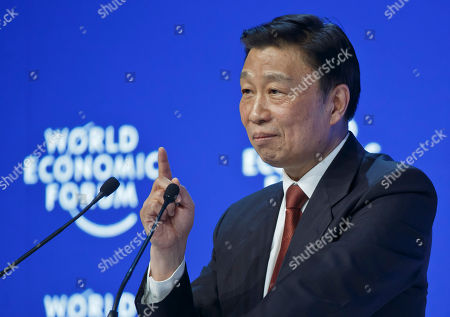 Chinese Vice President Li Yuanchao gestures as he speaks at a special session at the World Economic Forum in Davos, Switzerland, . World leaders are holding a flurry of diplomatic meetings at the World Economic Forum and worried CEOs are debating about how to deal with this year's volatile markets and low oil prices