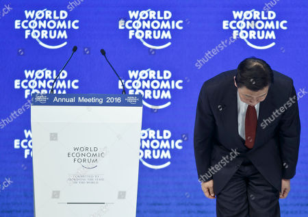 Chinese Vice President Li Yuanchao takes a bow as he arrives at a special session at the World Economic Forum in Davos, Switzerland, . World leaders are holding a flurry of diplomatic meetings at the World Economic Forum and worried CEOs are debating about how to deal with this year's volatile markets and low oil prices