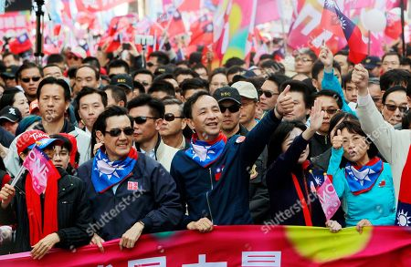 Eric Chu, Wang Ju-hsuan, Ma Ying-jeou Taiwan's ruling KMT, or Nationalist Party presidential candidate Eric Chu, center, and President Ma Ying-jeou, second from left, lead hundreds supporters during a campaign march through the streets of Taipei, Taiwan, . Taiwan will hold its presidential election on Jan. 16, 2016