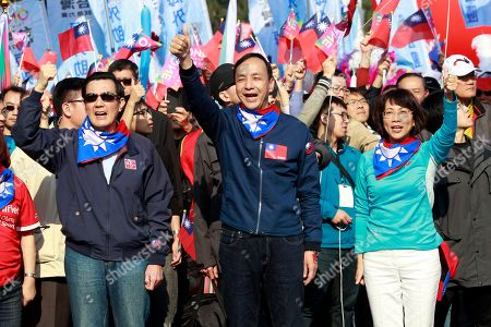 Stock Image of Eric Chu, Wang Ju-hsuan, Ma Ying-jeou Taiwan's ruling KMT, or Nationalist Party presidential candidate Eric Chu, center, vice presidential candidate Wang Ju-hsuan, right, and President Ma Ying-jeou, left, lead hundreds supporters during a campaign march through the streets of Taipei, Taiwan, . Taiwan will hold its presidential election on Jan. 16, 2016