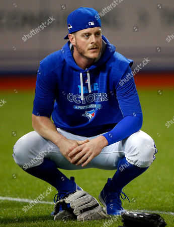 Toronto Blue Jays relief pitcher Mark Lowe watches during batting practice before Game 3 of baseball's American League Championship Series against the Kansas City Royals, in Toronto