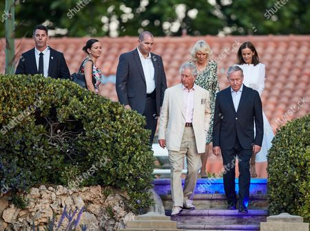 Stock Picture of Prince Charles Britain's Prince Charles, center, arrives to a barbecue to celebrate his birthday with Western Australia's Premier Colin Barnett, second right, and Camilla, Duchess of Cornwall, third right, in Perth, Australia, . The royal couple are on a 6-day visit of Australia