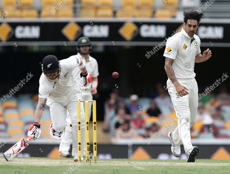 Brendon McCullum, Mitchell Johnson New Zealand's Brendon McCullum, left, completes a run as Australia's Mitchell Johnson, right, attempts to run him out during play on day five of their first cricket test match in Brisbane, Australia