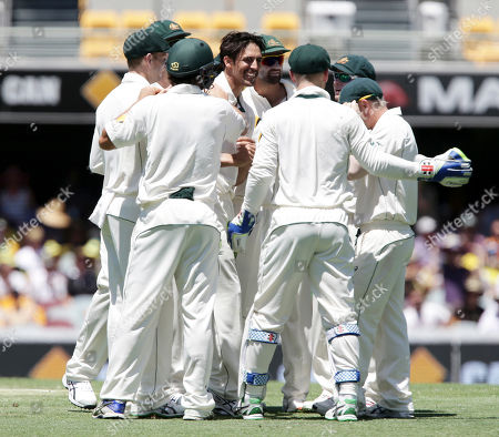 Mitchell Johnson Australia's Mitchell Johnson, center, celebrates with his team after getting the wicket of New Zealand's BJ Watling during play on day three of the first cricket test between Australia and New Zealand in Brisbane, Australia