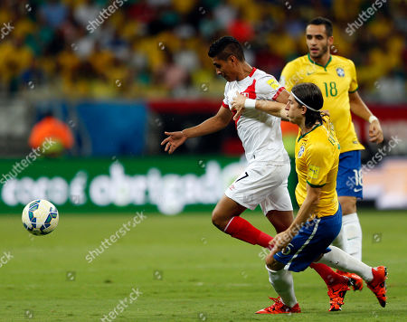 Brazil's Filipe Luis fights for the ball with Peru's Paolo Hurtado during a 2018 World Cup qualifying soccer match in Salvador, Brazil