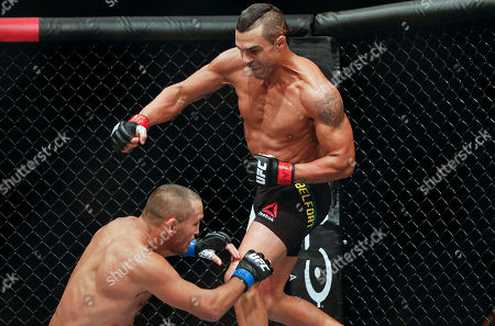 Stock Picture of Vitor Belfort, Dan Henderson Vitor Belfort, of Brazil, right, fights Dan Henderson, of the United States, during their UFC middleweight mixed martial arts bout in Sao Paulo, Brazil