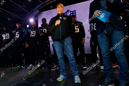 The Jacksonville Jaguars general manager David Caldwell speaks on stage during an NFL fan rally on Regent Street, in London, . The Buffalo Bills will play the Jacksonville Jaguars in an NFL football game at London's Wembley stadium on Sunday