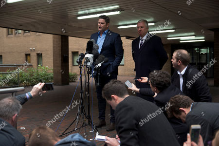 Former New Zealand cricket captain Chris Cairns speaks to the media after being found not-guilty in his perjury trial at Southwark Crown Court in London, . Cairns was cleared Monday of perjury and perverting the course of justice during a libel action about match-fixing but said he believes his career in the sport is over. The London jury cleared the retired cricketer of all charges at the end of a nine-week trial at Southwark Crown Court