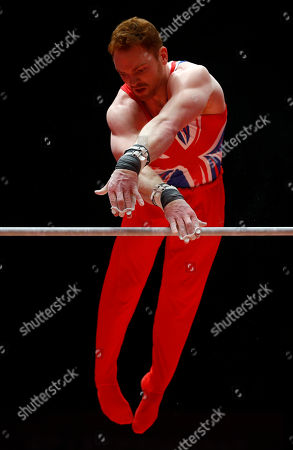 Britain's Daniel Purvis performs on the horizontal bar as he takes part in the men's qualification competition at the World Artistic Gymnastics championships in Glasgow, Scotland