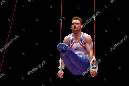 Britain's Daniel Purvis performs on the rings during the men's team final competition at the World Artistic Gymnastics championships at the SSE Hydro Arena in Glasgow, Scotland