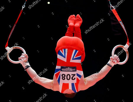 Britain's Daniel Purvis performs on the rings during the men's all-around final competition at the World Artistic Gymnastics championships at the SSE Hydro Arena in Glasgow, Scotland