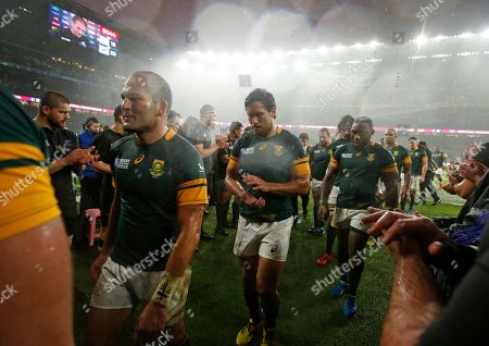 South Africa's captain Fourie Du Preez, left, leaves the field after the Rugby World Cup semifinal match between New Zealand and South Africa at Twickenham Stadium in London, . The All Blacks won the match 20-18