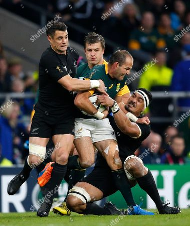 South Africa's captain Fourie Du Preez, centre, is tackled during the Rugby World Cup semifinal match between New Zealand and South Africa at Twickenham Stadium in London