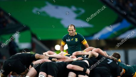 South Africa's captain Fourie Du Preez, centre, stands over a scrum during the Rugby World Cup semifinal match between New Zealand and South Africa at Twickenham Stadium in London