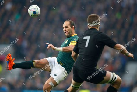 South Africa's captain Fourie Du Preez, left, clears the ball despite the challenge of New Zealand's captain Richie McCaw during the Rugby World Cup semifinal match between New Zealand and South Africa at Twickenham Stadium in London