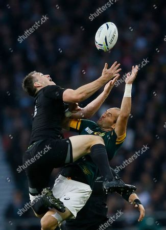 South Africa's captain Fourie Du Preez, right, competes for the ball with New Zealand's Ben Smith during the Rugby World Cup semifinal match between South Africa and New Zealand at Twickenham Stadium, London
