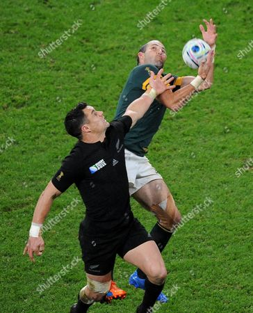 South Africa's Fourie du Preez, right, and New Zealand's Daniel Carter leap to compete for the ball during their Rugby World Cup semifinal match between South Africa and New Zealand at Twickenham Stadium, London