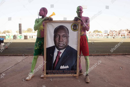 Zephirin Diabre On, men hold picture of Burkina Faso's Zephirin Diabre, center, from the UPC political party before elections to be held on Sunday in Ouagadougou, Burkina Faso. Last year, however, longtime strongman Blaise Compaore resigned amid protests that brought hundreds of thousands of Burkinabe into the streets, furious over the president's attempt to circumvent constitutional term limits and stay in office. The October 2014 uprising ushered in a transition that ends with presidential and legislative elections on Sunday, Nov. 29, 2015, the most hotly contested in the history of this West African nation
